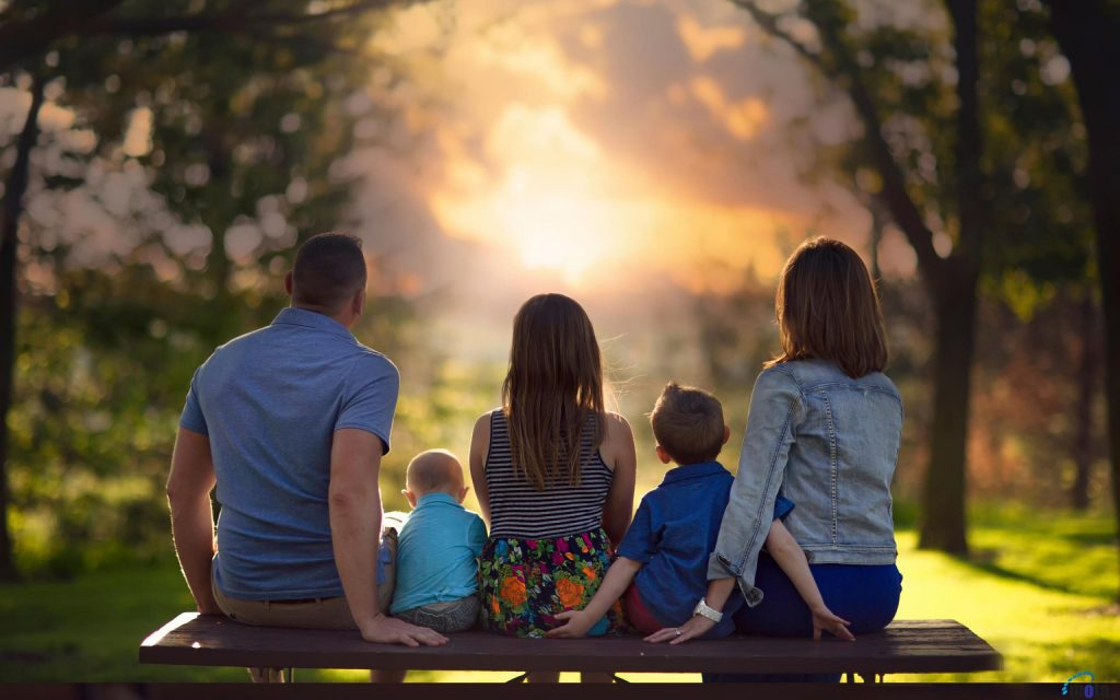 family watching sunset